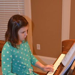 Emily McLaughlin, 10, practices the piano at her Houston home. Musical training is something Emily's parents find necessary.