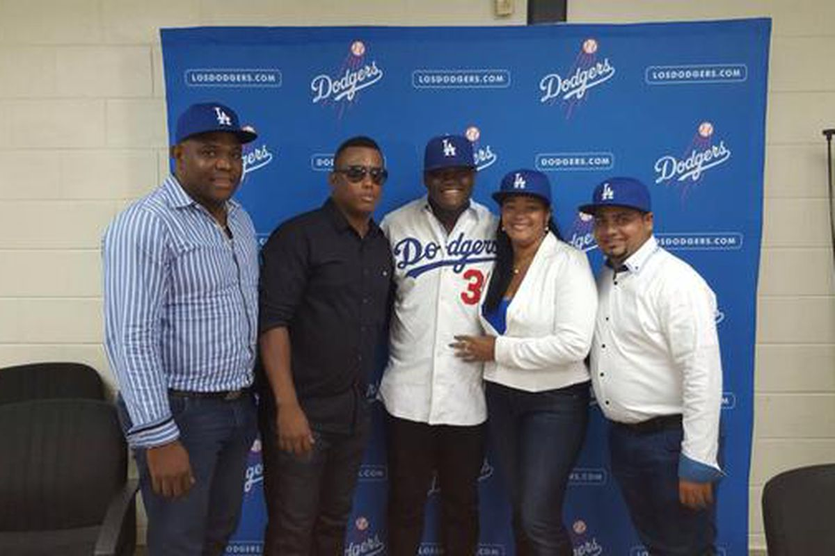 Dominican outfielder Starling Heredia signed with the Dodgers for a reported $2.6 million bonus.