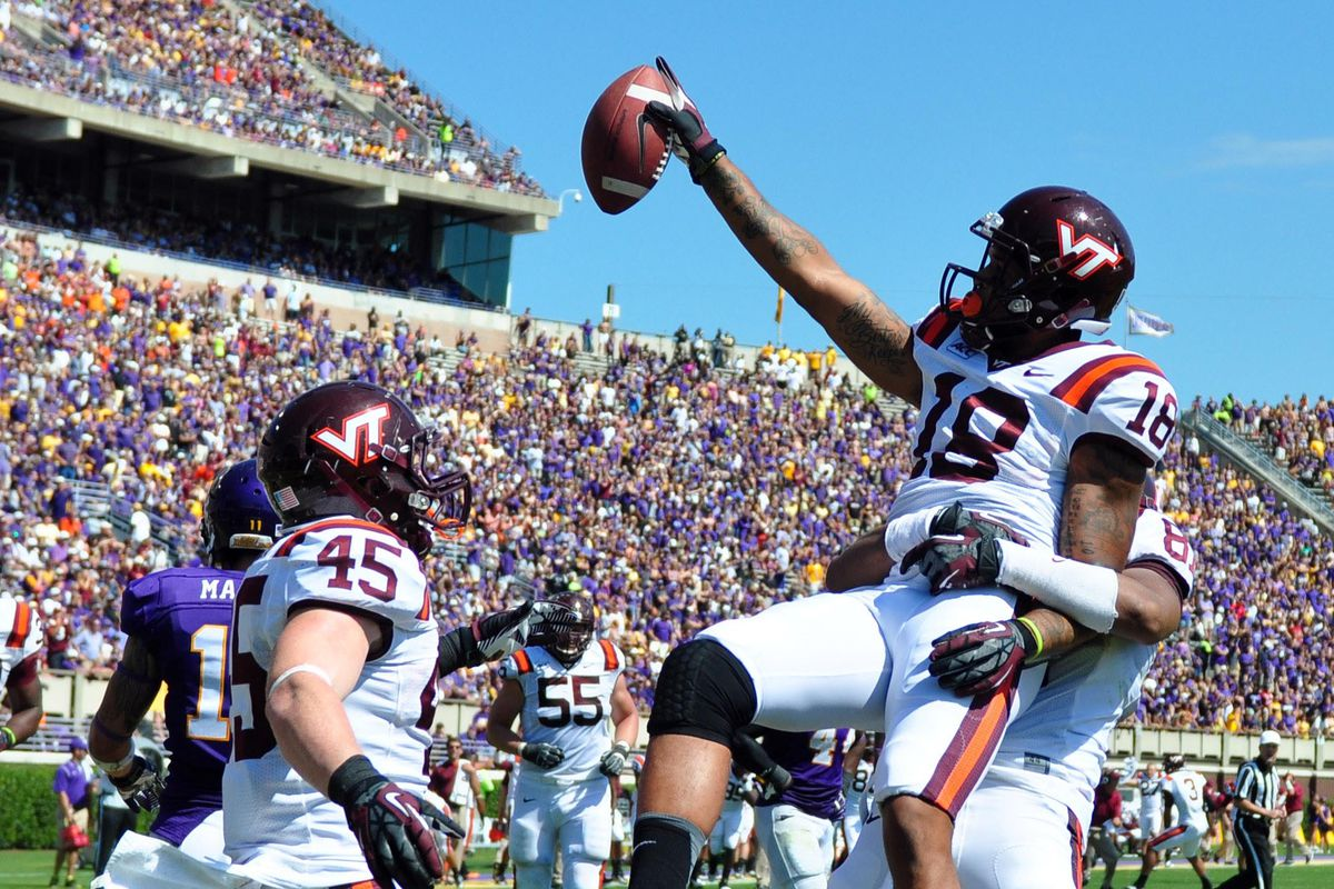 D.J. Coles celebrates with teammates following the touchdown that gave the Hokies the edge.
