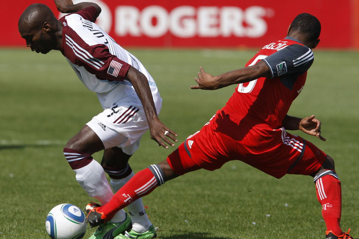 TORONTO, CANADA - SEPTEMBER 17: Julian de Guzman #6 of Toronto FC tries to stop Omar Cummings #14 of Colorado Rapids during MLS action at the BMO Field September 17, 2011 in Toronto, Ontario, Canada. (Photo by Abelimages/Getty Images)