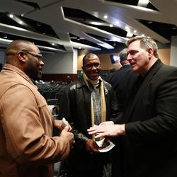Former BYU offensive lineman Trevor Matich, right, attends a public memorial service for former Cougar football coach LaVell Edwards at the Provo Convention Center on Friday, Jan. 6, 2017.