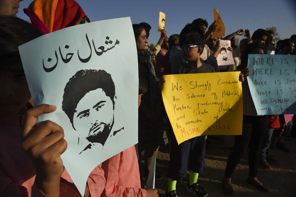 Pakistani civil society members and university students shout slogans and wave placards as they protest against the killing of Mashal Khan a journalism student, in Islamabad on April 15, 2017.