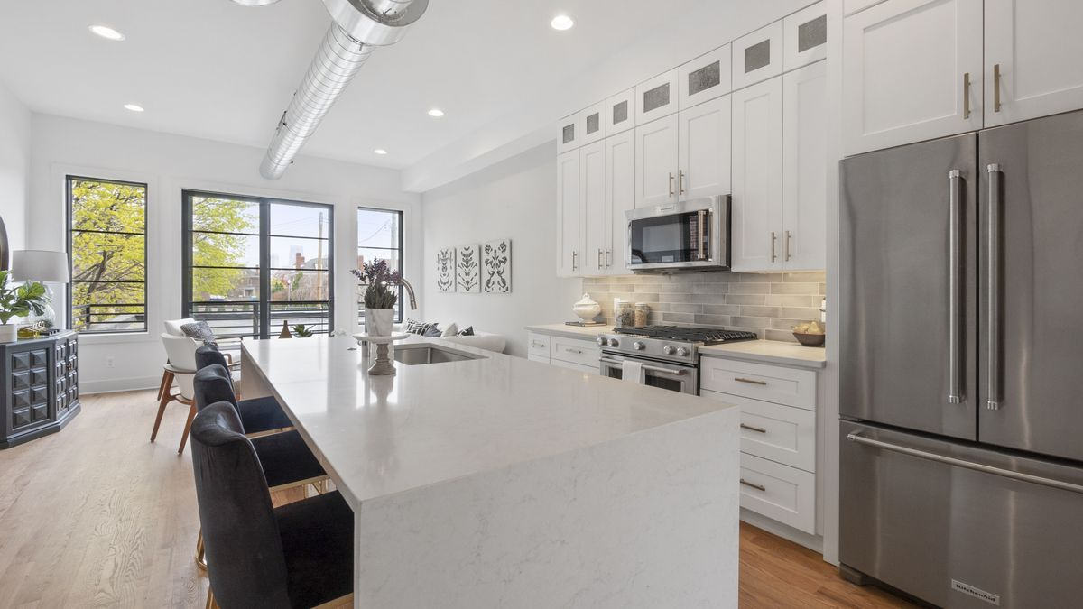 The kitchen comes with modern appliances and an island