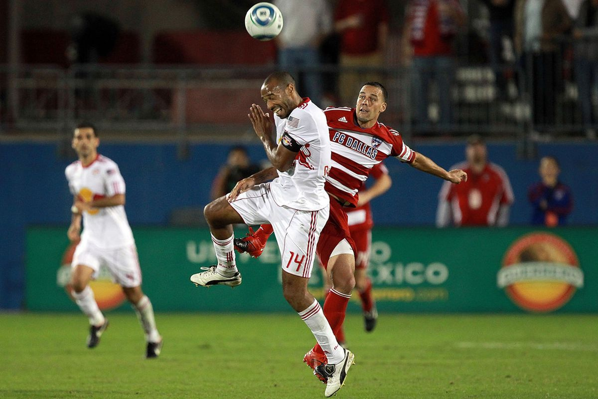 FRISCO, TX - OCTOBER 26:  Thierry Henry #14 of the New York Red Bulls on a header against Daniel Hernandez #2 of FC Dallas at Pizza Hut Park on October 26, 2011 in Frisco, Texas.  (Photo by Ronald Martinez/Getty Images)