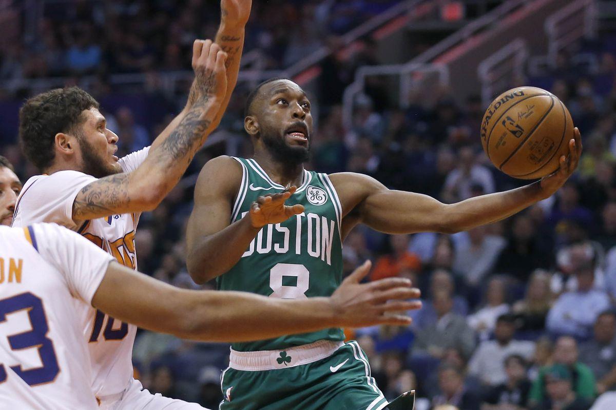 Boston Celtics guard Kemba Walker drives past Phoenix Suns guard Tyler Johnson in the second half of an NBA game at Talking Stick Resort Arena.