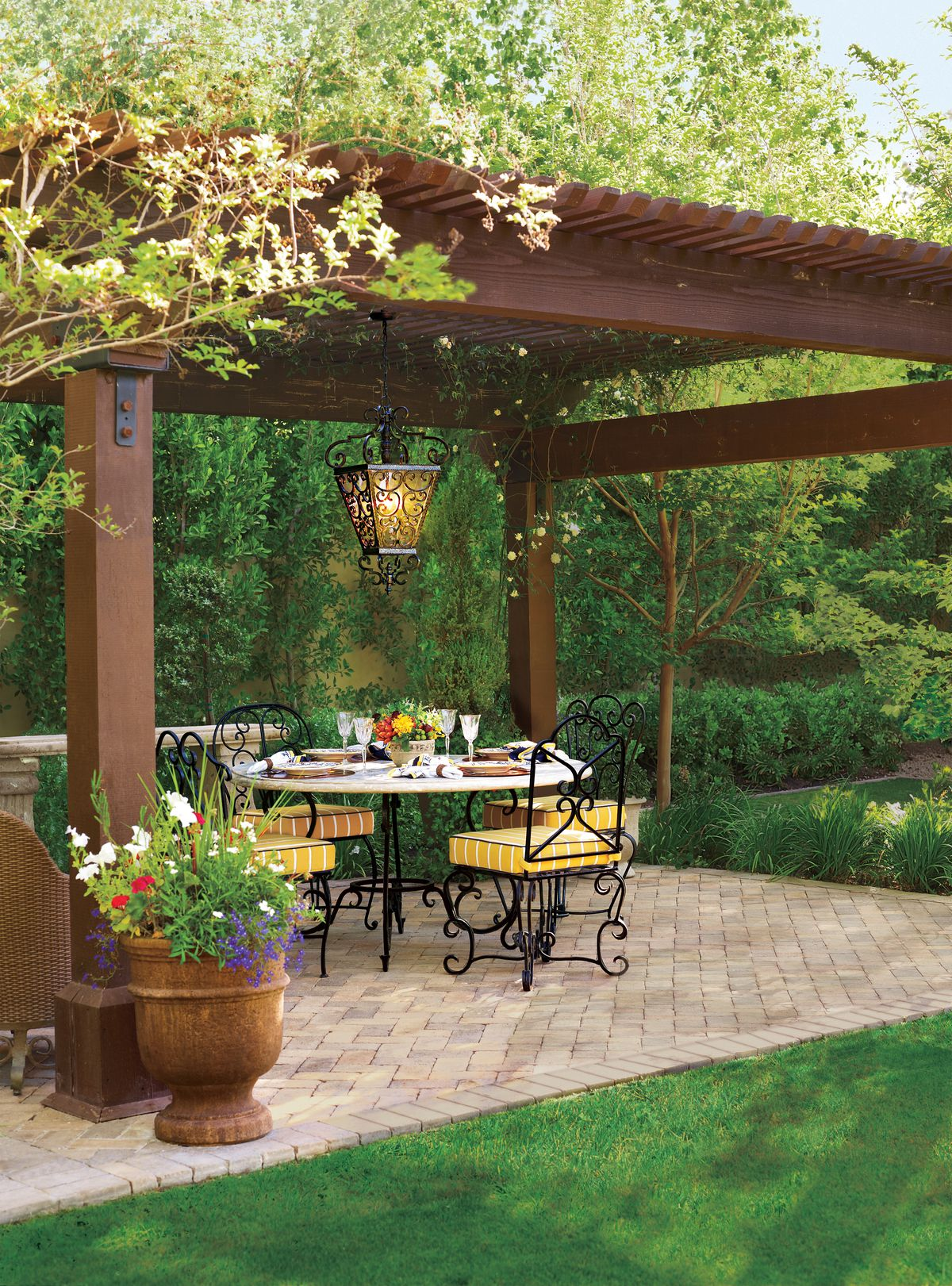 Patio with a pergola and outdoor tables and chairs.