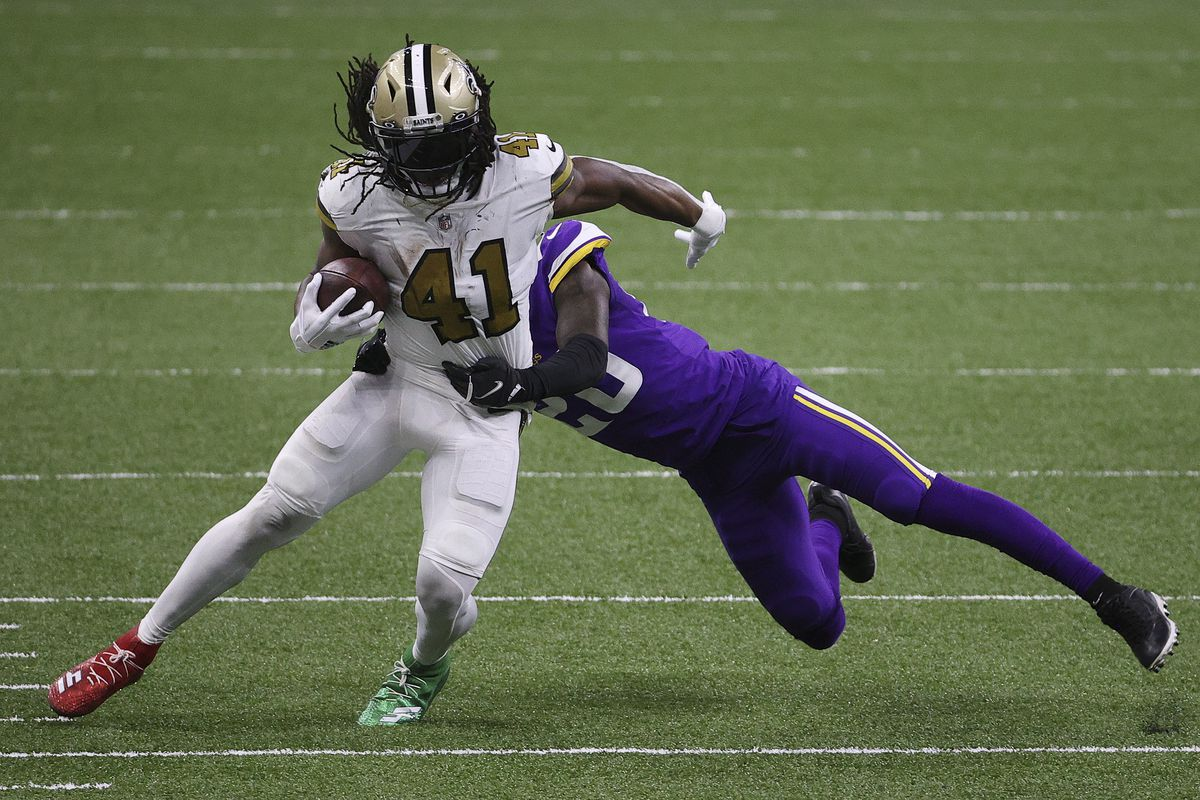 Alvin Kamara #41 of the New Orleans Saints makes a reception past Jeff Gladney #20 of the Minnesota Vikings during the fourth quarter at Mercedes-Benz Superdome on December 25, 2020 in New Orleans, Louisiana.