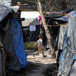 A boy runs in the migrant camp in Matamoros, Tamaulipas, Mexico, on Tuesday, Feb. 23, 2021.