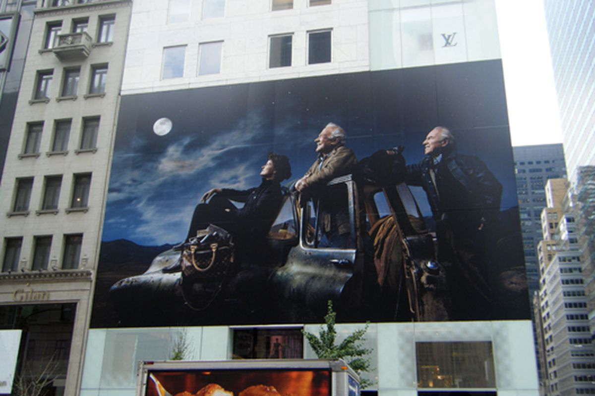"""Another look at the moon landing ad currently <a href=""""http://racked.com/archives/2009/07/16/in_the_window_louis_vuittons_conveyor_belt_history.php#more"""">wrapped around</a> Louis Vuitton's flagship store"""
