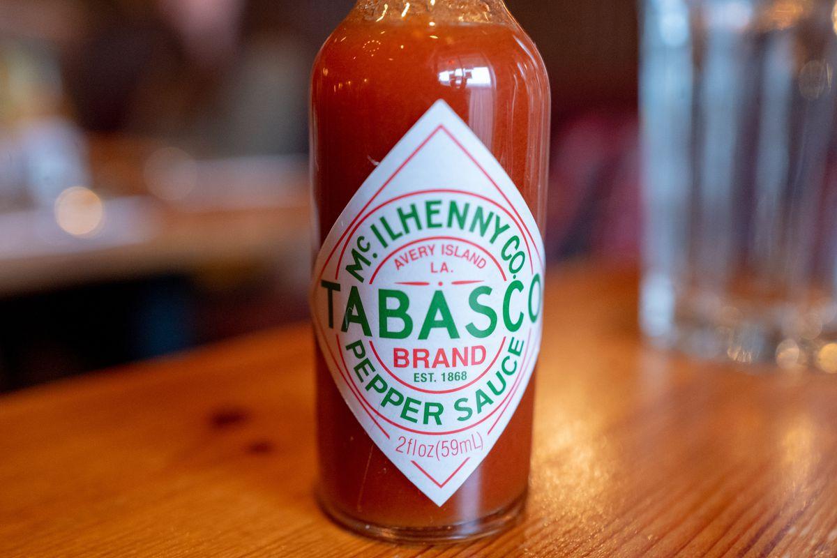 Close-up of Tabasco brand Louisiana style hot sauce on table, Berkeley, California, November 30, 2019.