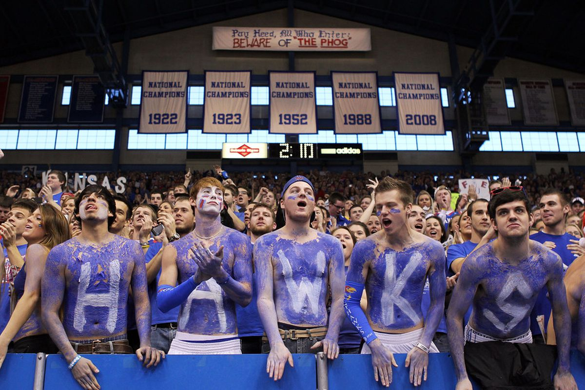 LAWRENCE, KS - DECEMBER 10:  Kansas Jayhawk fans cheer as the Jayhawks take the court prior to the start of the game against the Ohio State Buckeyes on December 10, 2011 at Allen Fieldhouse in Lawrence, Kansas.  (Photo by Jamie Squire/Getty Images)