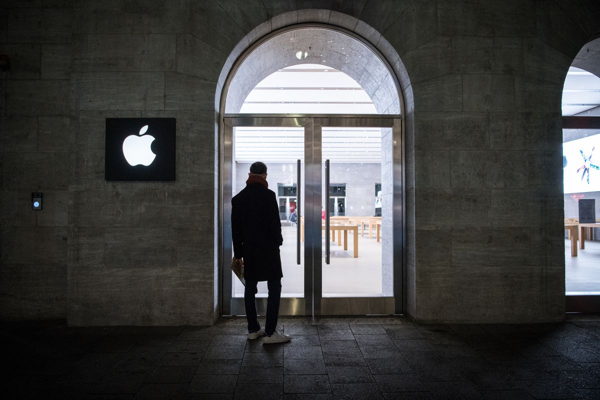 A man stands in front of an Apple store in Berlin, Germany, in December 2020.