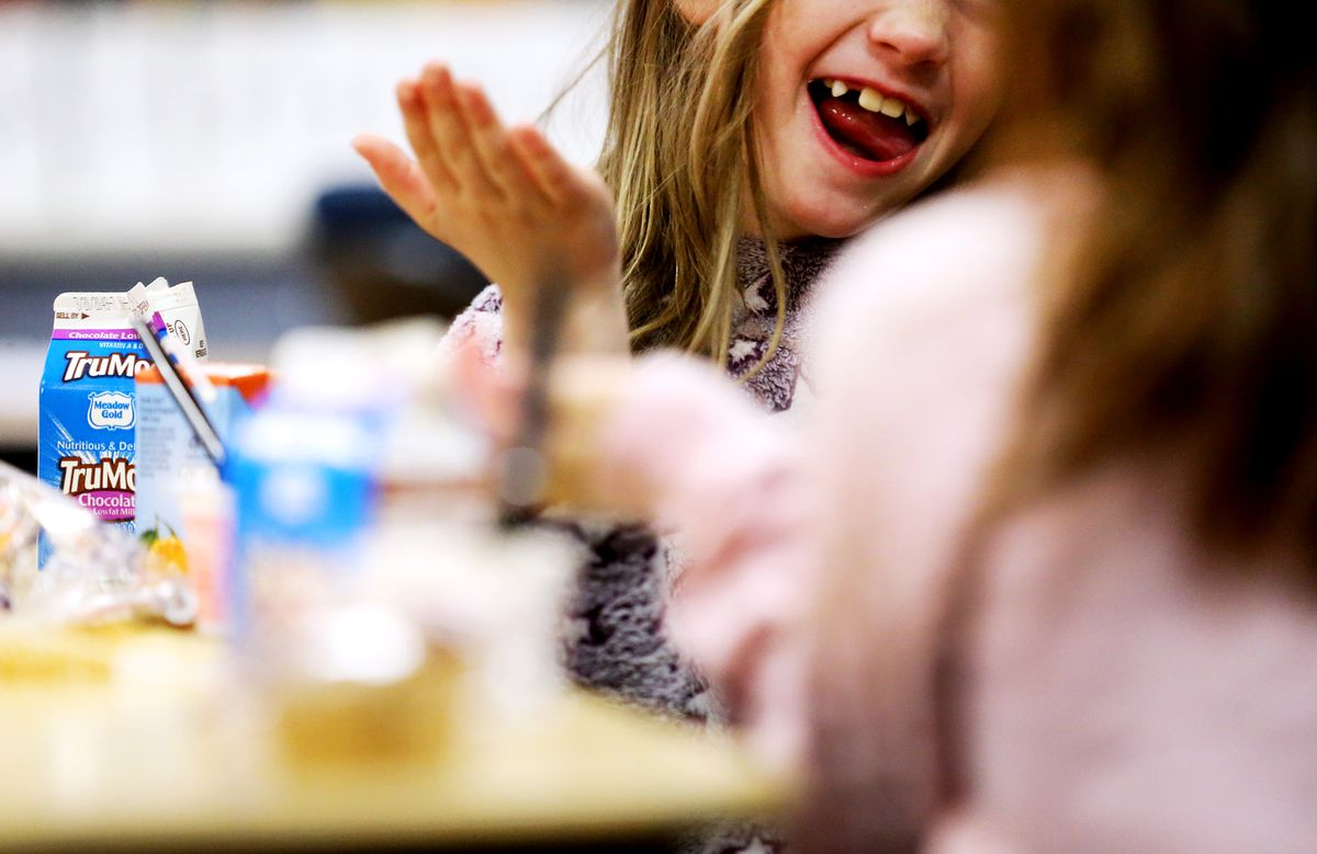 Students in one of the first grade classes at Woodrow Wilson Elementary in South Salt Lake City eat breakfast in class on Monday, March 9, 2020.