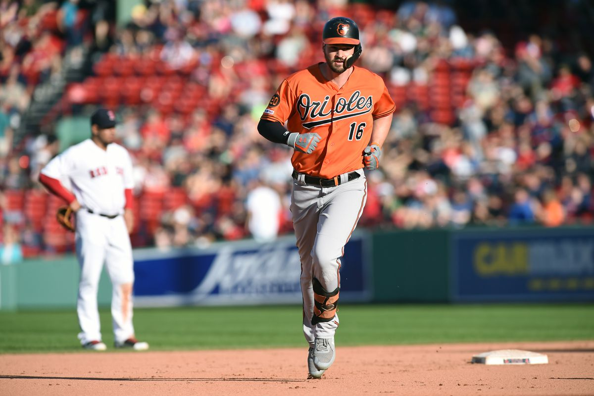 Baltimore Orioles left fielder Trey Mancini rounds the bases after hitting a home run during the ninth inning against the Baltimore Orioles at Fenway Park.