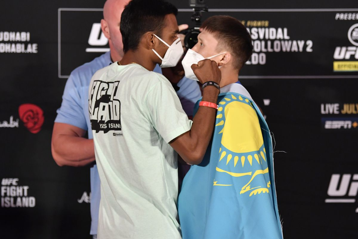 Opponents Raulian Paiva of Brazil and Zhalgas Zhumagulov of Kazakhstan face off during the UFC 251 official weigh-in inside Flash Forum at UFC Fight Island on July 10, 2020 on Yas Island Abu Dhabi, United Arab Emirates.