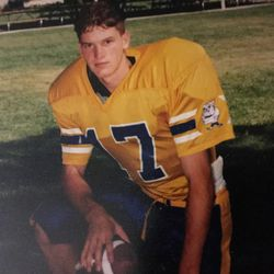 James Norman Jr. poses for a photo in his high school football uniform.