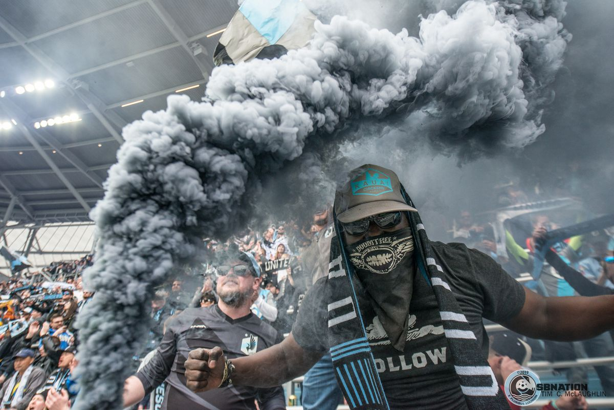 Supporters celebrate Minnesota United's first victory at Allianz Field