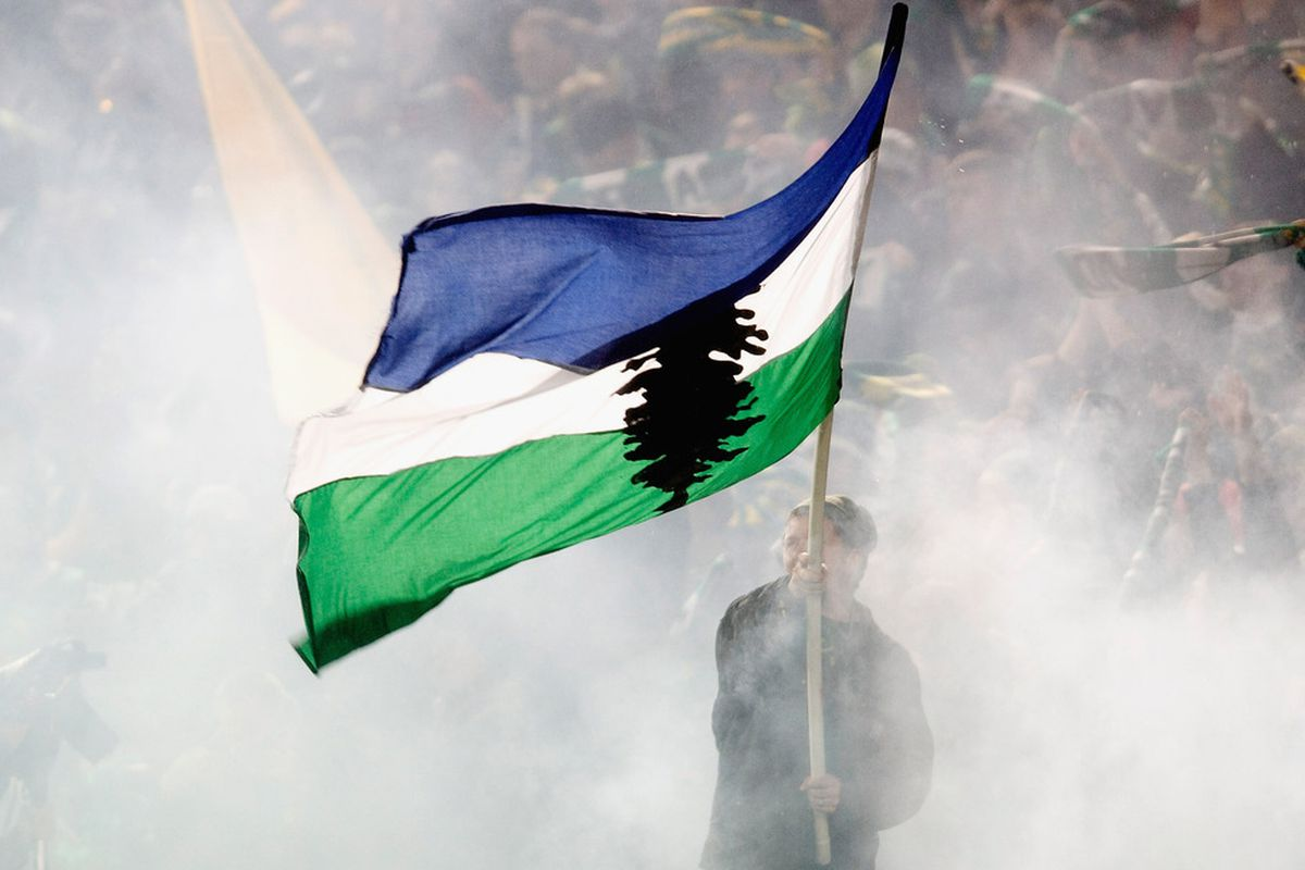 PORTLAND, OR - APRIL 14: Portland Timbers fan waves a flag after the Timbers scored during the first half of the home opener at Jeld-Wen Field on April 14, 2011 in Portland, Oregon. (Photo by Steve Dykes/Getty Images)
