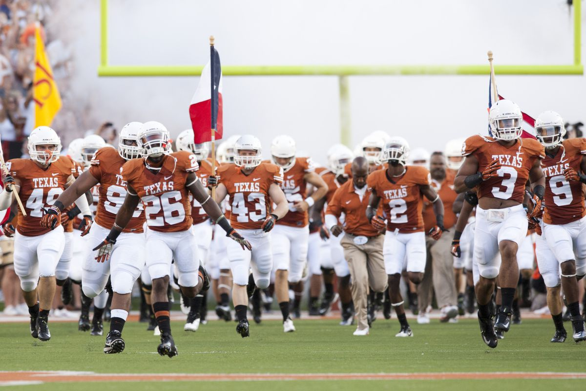 AUSTIN, TX - SEPTEMBER 1: The University of Texas Longhorns take the field prior to playing the Wyoming Cowboys on September 1, 2012 at Darrell K Royal-Texas Memorial Stadium in Austin, Texas.  (Photo by Cooper Neill/Getty Images)