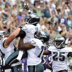 From left to right, Philadelphia Eagles' Danny Watkins, Michael Vick and Demetress Bell and LeSean McCoy celebrate after Vick's rushing touchdown in the second half of an NFL football game against the Baltimore Ravens, Sunday, Sept. 16, 2012, in Philadelphia. Philadelphia won 24-23.