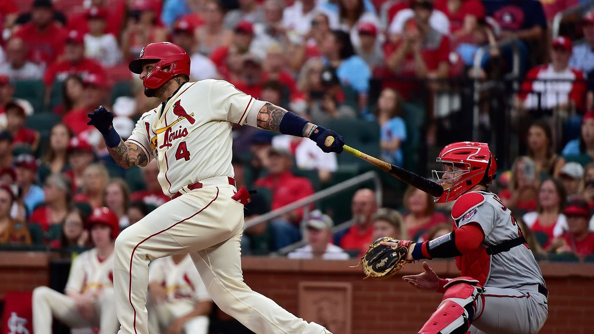 St. Louis Cardinals catcher Yadier Molina (4) hits a single during the second inning against the Minnesota Twins at Busch Stadium. Mandatory Credit: Jeff Curry