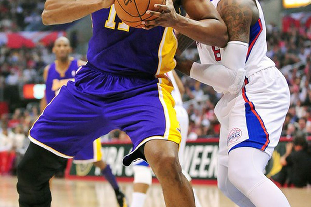 April 4, 2012; Los Angeles, CA, USA; Los Angeles Lakers center Andrew Bynum (17) controls the ball against the Los Angeles Clippers during the first half at Staples Center. Mandatory Credit: Gary A. Vasquez-US PRESSWIRE