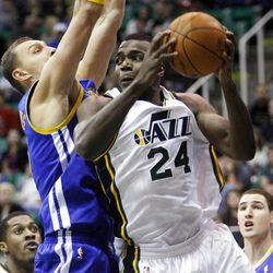 Utah Jazz forward Paul Millsap (24) looks to pass around Golden State's #15 Andris Biedrins as the Utah Jazz and the Golden State Warriors play Friday, April 6, 2012 in Salt Lake City. Jazz won 104-98.