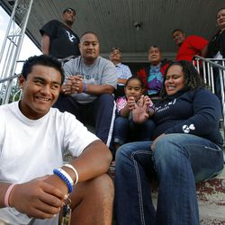 Patrick Palau sits on the steps of his home with his family. He'll play for BYU when he returns from an LDS Mission.