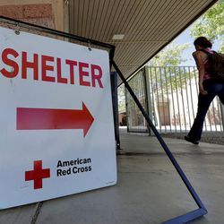 An evacuee from the Goodwin fire enters a Red Cross shelter, Wednesday, June 28, 2017, in Prescott Valley, Ariz. Forest officials say over a dozen campground and other recreation areas have been closed because of the wildfire in northern Arizona.