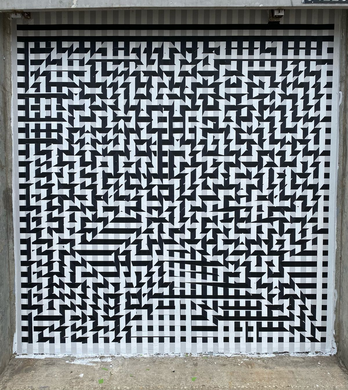 """Daniel Shoykhet's mural """"KVTNO9"""" at Hubbard Street and Milwaukee Avenue stands for """"Kinetic Visual Test Number 9."""" It's the ninth installment in a series. He says he hopes to do at least 60 more works in the same series."""