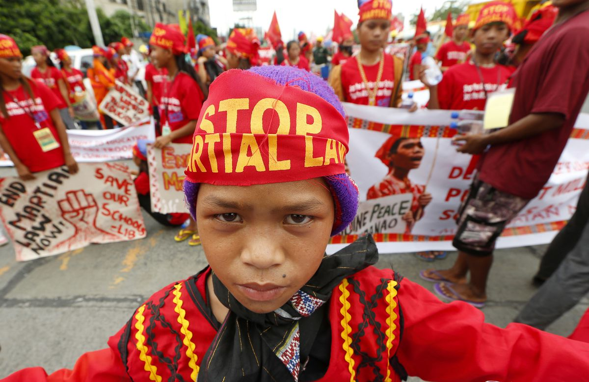 Indigenous people known as Lumads carry banners as they join a march of thousands of protesters to coincide with the state of the nation address of Philippine President Rodrigo Duterte in Quezon city, northeast of Manila, in the Philippines. | Bullit Marq