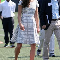 Wearing a checked Hobbs dress on a visit to Bacon's College in London on July 26th, 2012.
