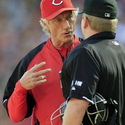 Cincinnati Reds acting manager Chris Speier, left, questions a call with home plate umpire Mike Muchlinski during a baseball game against the Los Angeles Dodgers, Saturday, Sept. 22, 2012, in Cincinnati. Reds manager Dusty Baker remained in a Chicago hospital after experiencing an irregular heartbeat.