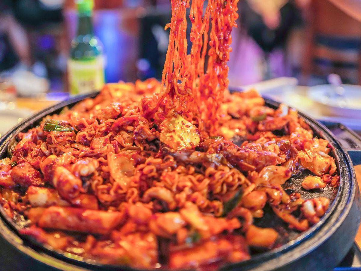 The stir-fried pork belly and octopus with noodles at Seoulju