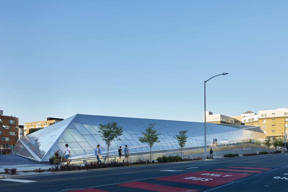 An angular modern building with a reflective facade