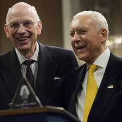"""Senator Robert F. Bennett (left) and Senator Orrin Hatch have a laugh following the presentation of the King's Peak Leadership Award of Utah State Society to Bennett in the Dirksen Senate Building in Washington D.C. on Wednesday, Nov., 17, 2010. The departing junior senator was honored by the Utah State Society for his years serving Utah and the United States.   """"Sen. Bennett has been one of the most well respected senators across party boundaries for many years,"""" said President of the Utah State Society Daine M. Hansen. """"With his help, Utah has really flourished in many areas. Because of that, we had to recognize him for the service as he's getting ready to depart the Senate."""""""