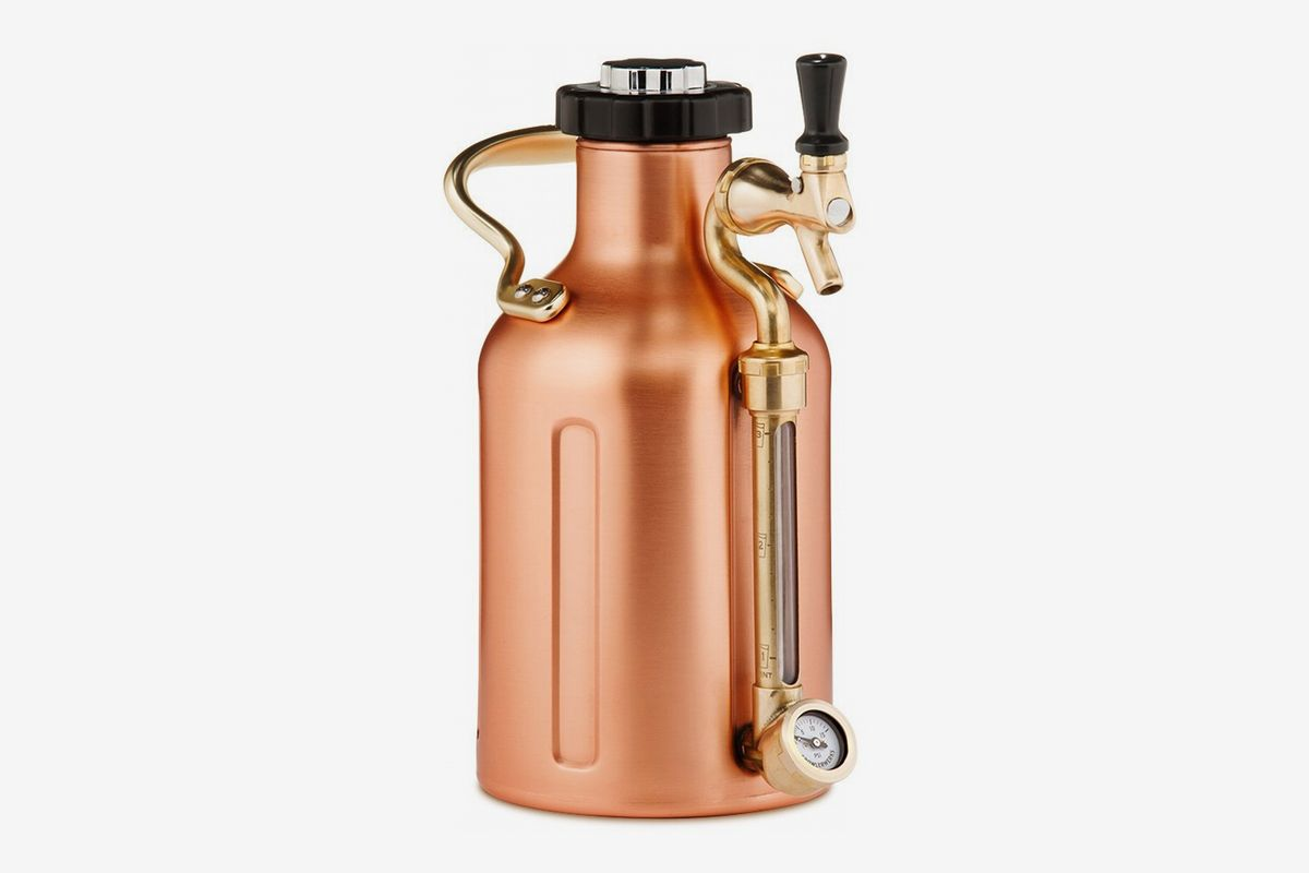 A stainless-steel growler with a pressure gauge and a carbonation cap