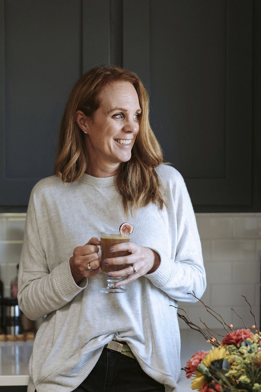 Marnie Rae Clark drinks a Curried Apricot Hot Buttered Mocktail. Clark founded National Mocktail Week this year with a mission of working directly with bars and restaurants to up their mocktail games
