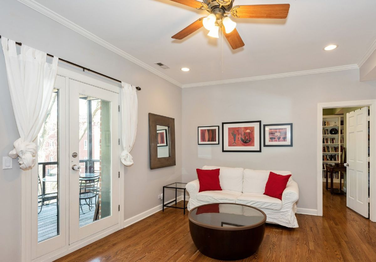 The listing-friendly version of the former Esposito home, its Tuscan yellow walls swapped for a muted gray.