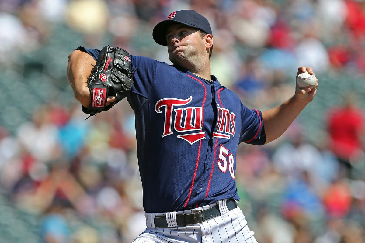 Aug 1, 2012; Minneapolis, MN, USA: Minnesota Twins starting pitcher Scott Diamond (58) delivers a pitch in the first inning against the Chicago White Sox at Target Field. Mandatory Credit: Jesse Johnson-US PRESSWIRE