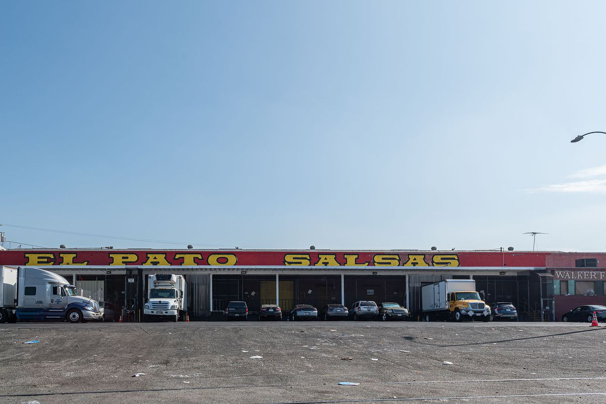 An open parking lot with red signage for El Pato Salsa.