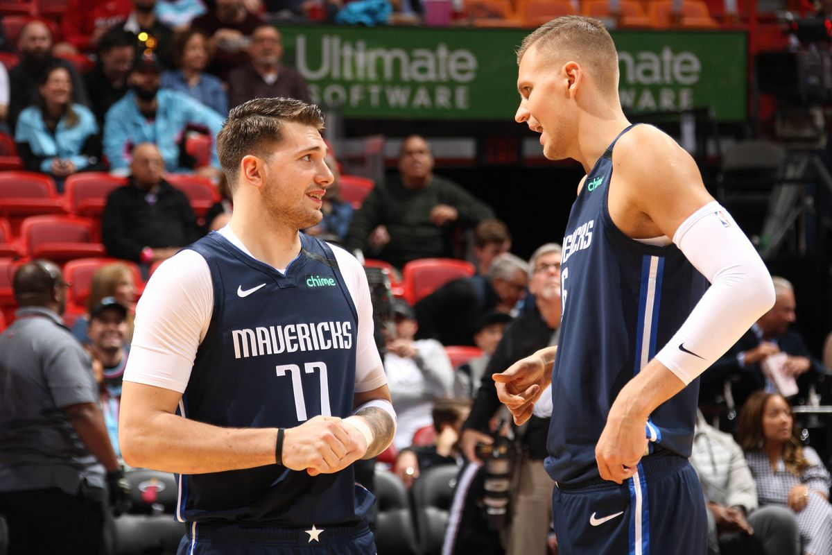 Luka Doncic of the Dallas Mavericks talks with Kristaps Porzingis #6 of the Dallas Mavericks before the game on February 28, 2020 at American Airlines Arena in Miami, Florida.