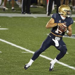 Navy quarterback Perry Olsen drops back to pass during the second half of an NCAA college football game against the BYU, Monday, Sept. 7, 2020, in Annapolis, Md.
