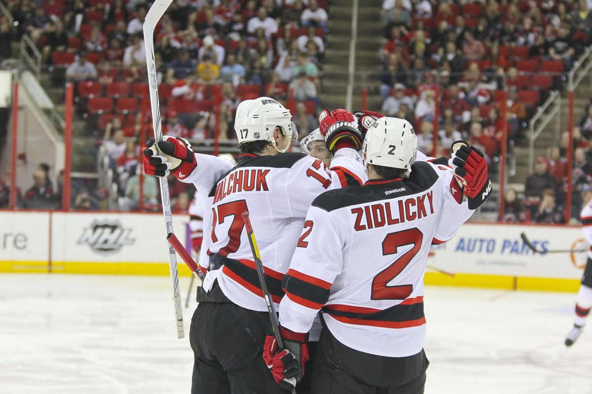 March 31, 2012; Raleigh, NC, USA; New Jersey Devils left wing Ilya Kovalchuk (17) celebrates his 2nd period goal with teammates against the Carolina Hurricanes at the PNC center. The Devils won, 5-0.  Mandatory Credit: James Guillory-US PRESSWIRE