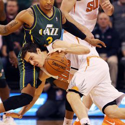 Goran Dragic (1) of the Phoenix Suns drives and looses the ball against Trey Burke (3) of the Utah Jazz during NBA basketball in Salt Lake City, Friday, Nov. 29, 2013.