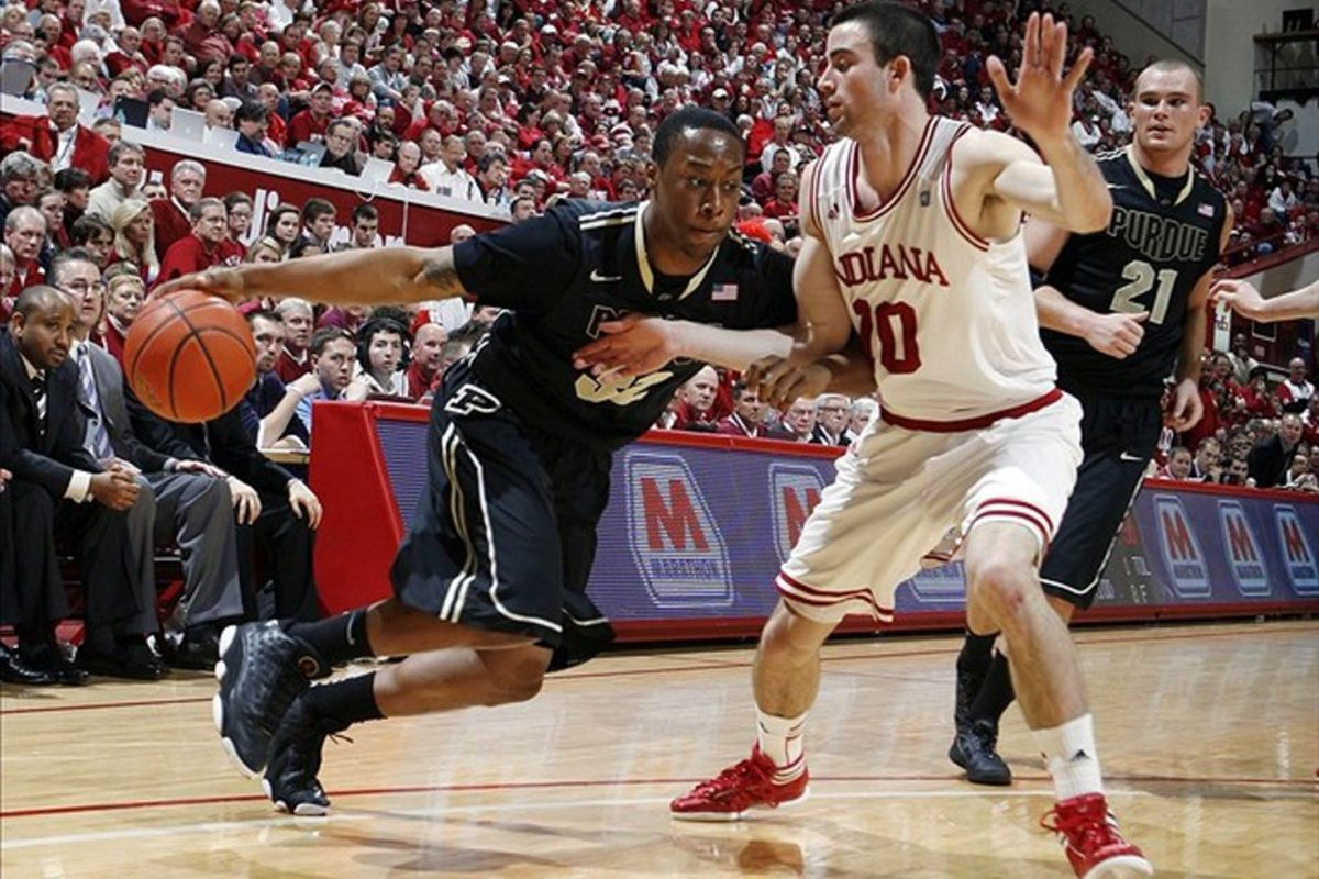 Mar 4, 2012; Bloomington, IN, USA; Purdue Boilermakers guard John Hart  (32) drives to the basket against Indiana Hoosiers guard Will Sheehey (10) at Assembly Hall. Indiana defeated Purdue 85-74.  Mandatory Credit: Brian Spurlock-US PRESSWIRE
