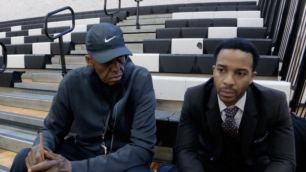 Bill Duke and André Holland sit on the bleachers in High Flying Bird.