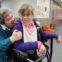 Intervenor Tuan Thatcher, left, laughs with Maura Lloyd at Jordan Valley School in Midvale Tuesday, Feb. 19, 2013. Lloyd does not speak and has severe visual and hearing impairments.