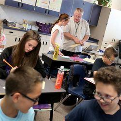 Darren Stirland works with his sixth-grade students at South Jordan Elementary School on Wednesday, June 8, 2016.