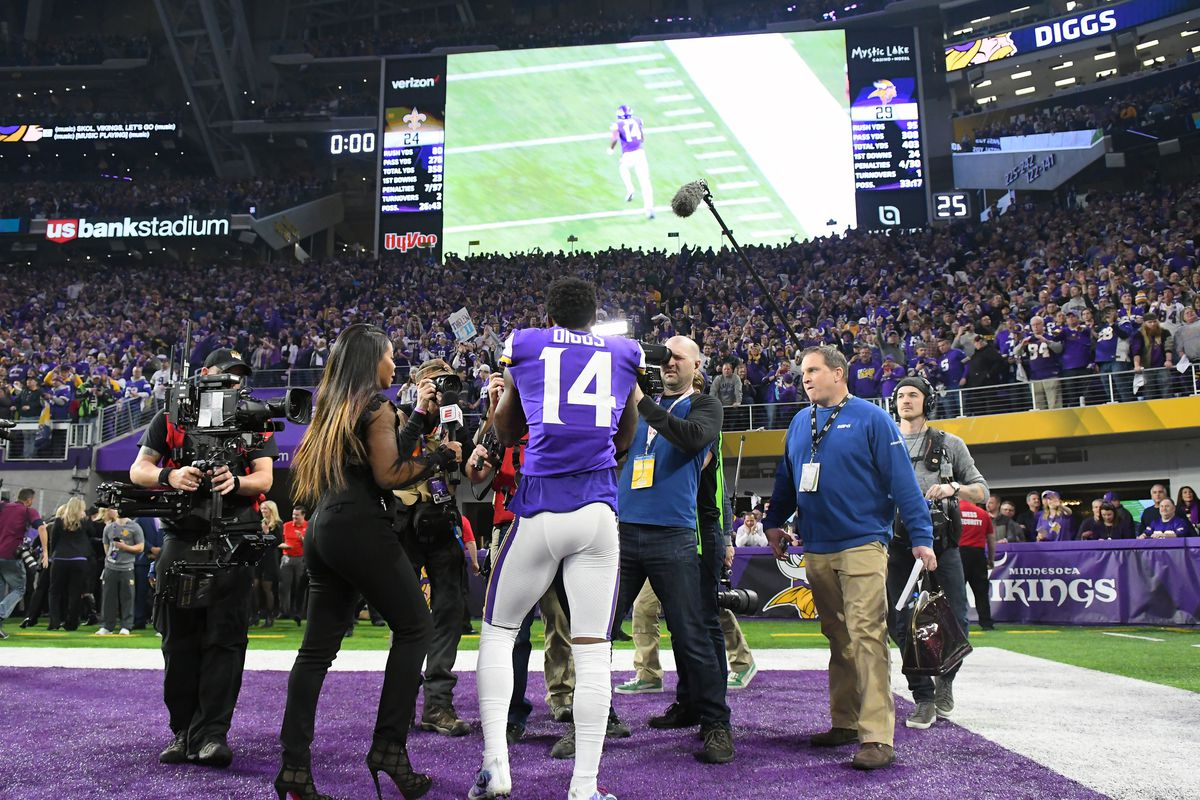 Stefon Diggs's back as he watches a replay of his touchdown